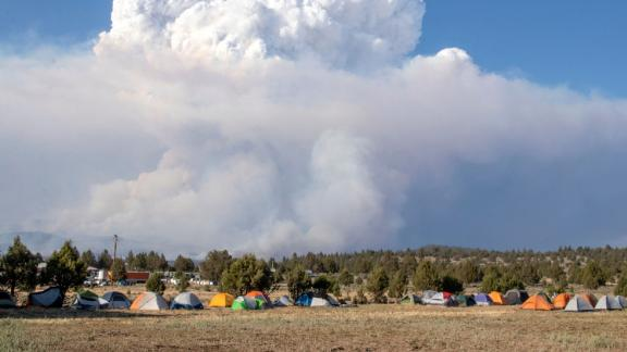 A pyrocumulus cloud caused by the Bootleg Fire drifts north of a firefighter operating base in Bly, Oregon, on July 15.