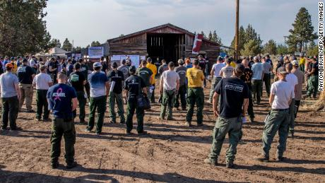 The Bootleg Fire night crew listens to a briefing at their operating base in Bly, Oregon, on July 15, 2021.