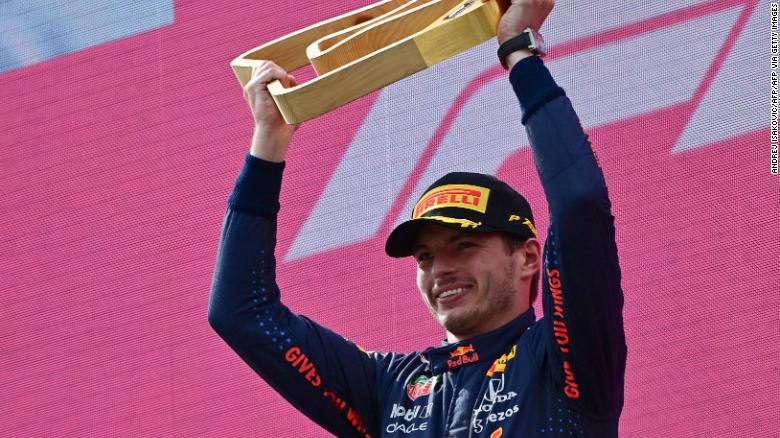Red Bull's Dutch driver Max Verstappen celebrates with his trophy on the podium after winning the Formula One Austrian Grand Prix at the Red Bull Ring race track in Spielberg, Austria, on July 4, 2021. (Photo by ANDREJ ISAKOVIC / AFP) (Photo by ANDREJ ISAKOVIC/AFP via Getty Images)