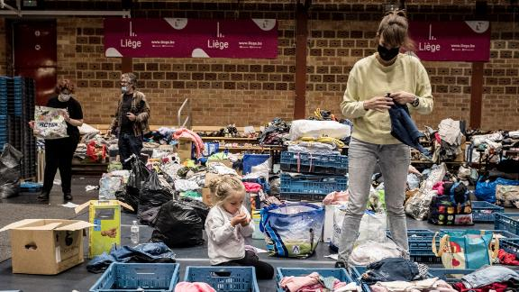 A woman sorts through clothing at a shelter in Liege, Belgium, on Friday.
