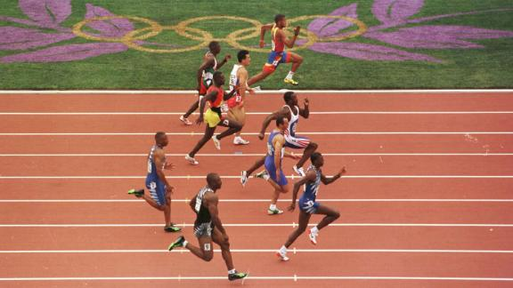 Linford Christie of Great Britain wins his heat in the first round of the men's 100m at the 1996 Centennial Games in in Atlantia, Georgia. Great care was taken in Atlanta to protect athletes and fans from the heat.
