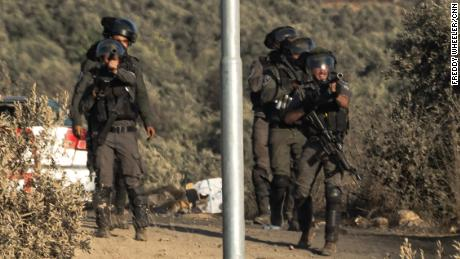 Israeli soldiers ready to fire tear gas canisters in Beita.
