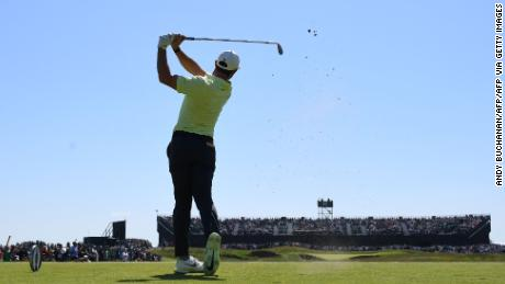 McIlroy tees off on the 16th during his second round of The Open.