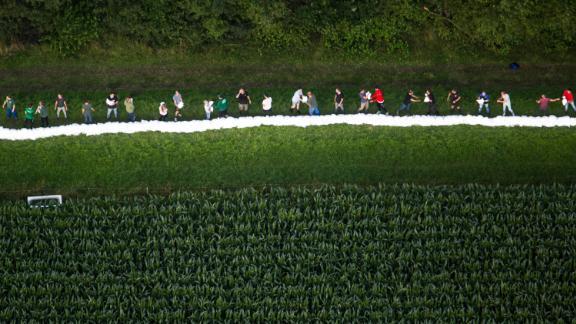 People lay sandbags in Roermond, Netherlands, on July 16.