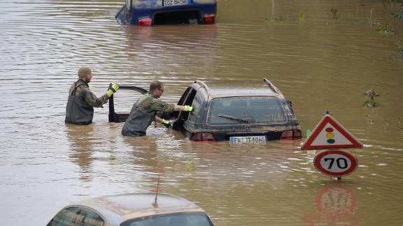 TOPSHOT - Soldiers of the German armed forces Bundeswehr search for flood victims in submerged vehicles on the federal highway B265 in Erftstadt, western Germany, on July 17, 2021, after heavy rains hit parts of the country, causing widespread flooding and major damage. - Rescue workers scrambled on July 17 to find survivors and victims of the devastation wreaked by the worst floods to hit western Europe in living memory, which have already left more than 150 people dead and dozens more missing. (Photo by SEBASTIEN BOZON / AFP) (Photo by SEBASTIEN BOZON/AFP via Getty Images)