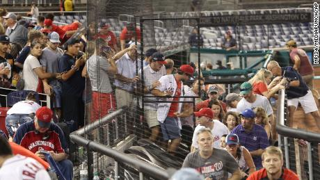 Fans leave their seats as a shooting took place outside Nationals Park during an MLB game in Washington, DC, on July 17, 2021.