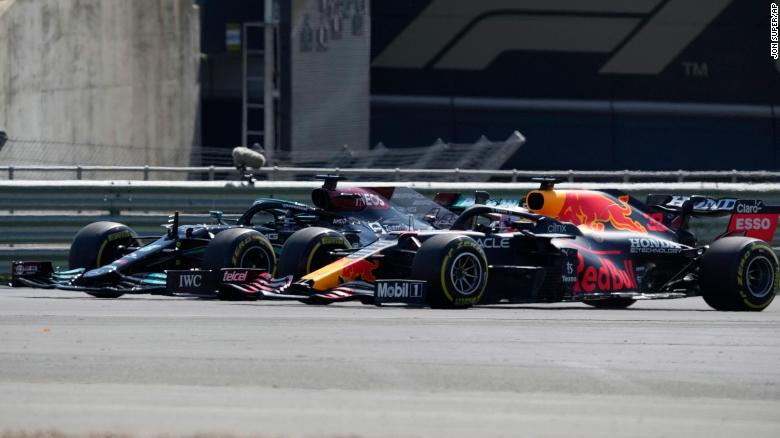 Hamilton (left) and Verstappen take a curve side-by-side at the start of the British Grand Prix.