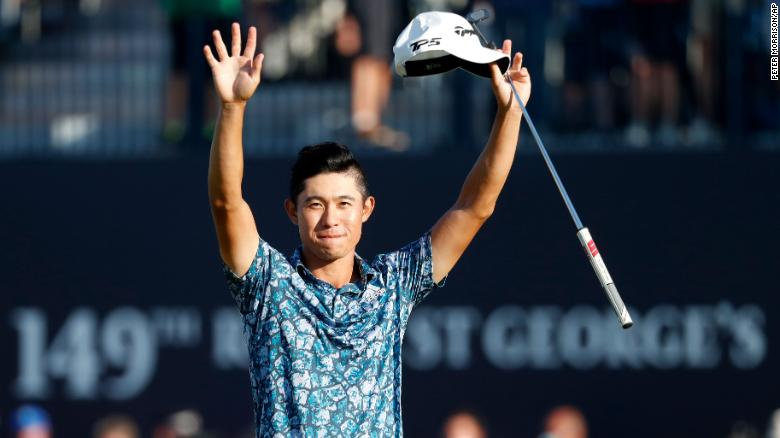 Morikawa celebrates on the 18th green after winning the Open.