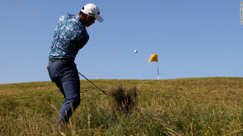 Morikawa plays a shot on the 10th hole from the rough during the final round of the Open.