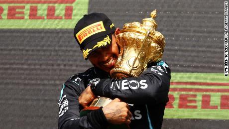 Lewis Hamilton celebrates on the podium at Silverstone.