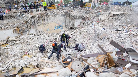 Task force members working at the residential building collapse site in Miami-Dade County, Florida are seen in this photo released by the Miami-Dade Fire Rescue on July 10.