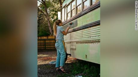Abi Roberts painting the bus before the trip.