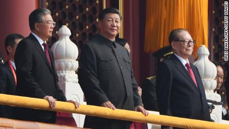 Chinese President Xi Jinping, center, attends a military parade with former presidents Hu Jintao, left, and Jiang Zemin in Tiananmen Square in Beijing on October 1, 2019.