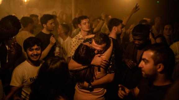 Two people hug at the Egg nightclub in London early Monday.