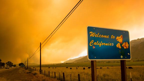 The Tamarack Fire burns in Markleeville, California, near the Nevada border, on Saturday, July 17. The fire was sparked by lightning on July 4 and has triggered mandatory evacuations for a number of campgrounds and neighborhoods in the area.