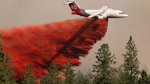 An airplane drops fire retardant on the Chuweah Creek Fire in Washington on July 14.