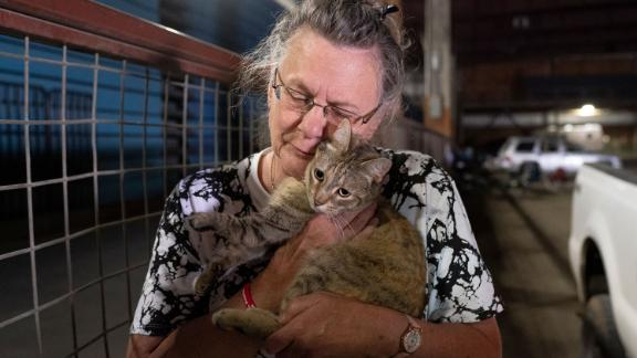 Evacuee Dee McCarley hugs her cat Bunny at a Red Cross center in Klamath Falls, Oregon, on Wednesday, July 14.