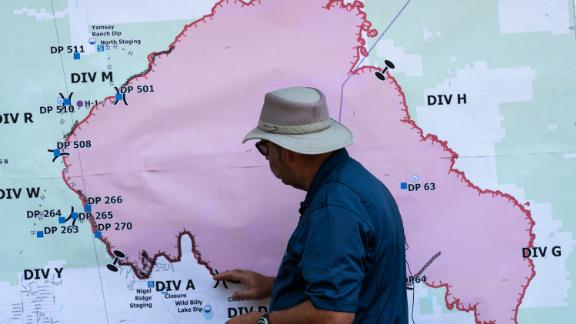 Operations Section Chief Bert Thayer examines a map of the Bootleg Fire in Chiloquin, Oregon, on Tuesday, July 13.