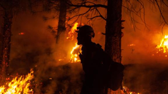 A firefighter battles the Bootleg Fire in the Fremont-Winema National Forest, along the Oregon and California border, on Thursday, July 15.