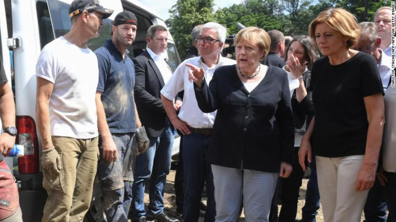 German Chancellor Angela Merkel, second right, and Rhineland-Palatinate State Premier Malu Dreyer, right, talk to residents during their visit to Schuld on July 18 after the flood hit.