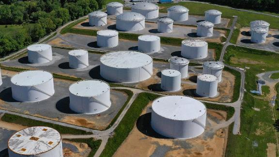 In an aerial view, fuel holding tanks are seen at Colonial Pipeline's Dorsey Junction Station on May 13, 2021 in Woodbine, Maryland.