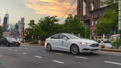 An autonomous vehicle from Mobileye's autonomous test fleet is parked in front of the Manhattan Bridge in June 2021.
