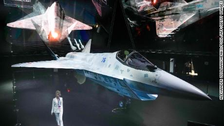 """A prototype of Russia's new Sukhoi Checkmate Fighter is on display during the presentation at the MAKS 2021 International Aviation and Space Salon, in Zhukovsky, outside Moscow, on July 20, 2021. - Russian President Vladimir Putin got a sneak peek of a next-generation stealth fighter jet dubbed """"The Checkmate"""" ahead of the official unveiling later in the day. (Photo by Alexander Zemlianichenko / POOL / AFP) (Photo by ALEXANDER ZEMLIANICHENKO/POOL/AFP via Getty Images)"""