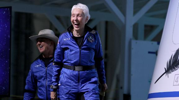 Blue Origin's New Shepard crew (L-R) Jeff Bezos and Wally Funk arrive for a press conference after flying into space in the Blue Origin New Shepard rocket on July 20, 2021 in Van Horn, Texas. Mr. Bezos and the crew were the first human spaceflight for the company.