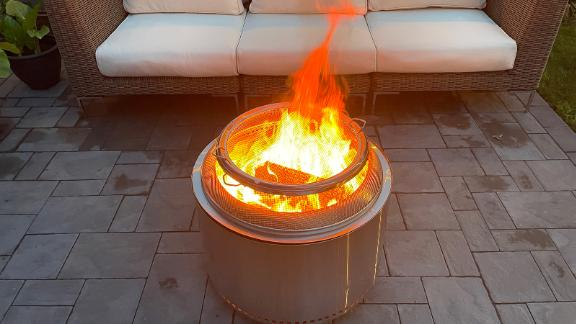 A Solo Stove Yukon fire pit and protective shield.