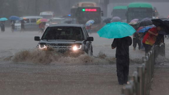 Heavy flooding has hit central China following unusually heavy rains, with the subway system in the city of Zhengzhou inundated with rushing water.