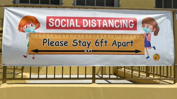 A social distancing sign with coronavirus COVID-19 safety precautions at Morris K. Hamasaki Elementary School, Thursday, July 1, 2021, in Los Angeles.(Kirby Lee via AP)