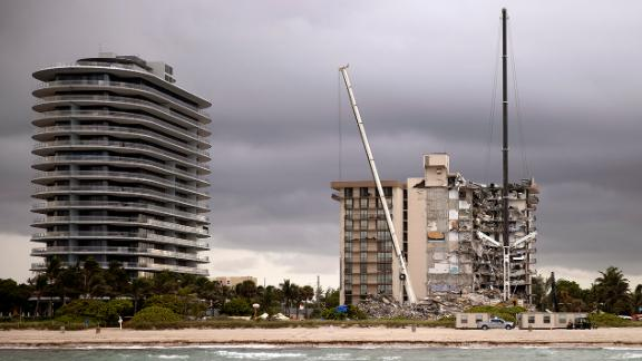 Condo Collapse: The towering pile of concrete and debris from the Surfside condo collapse is now almost an empty pit