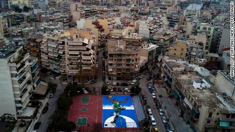 Artwork of Giannis Antetokounmpo on a basketball court in Athens.