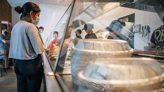 Chipotle announced a wage hike in May.
