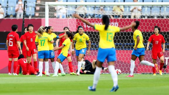 Marta celebrates with teammates after scoring her team's first goal against China.