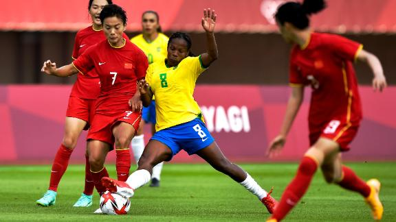 Shuang Wang and Formiga battle for possession.