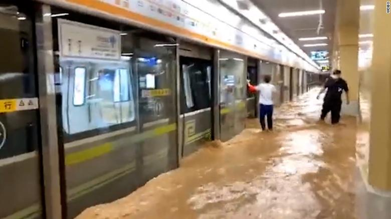 china,floods,Passengers trapped inside submerged subway as deadly floods sweep central China,harbouchanews