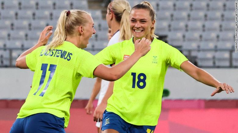 Sweden's forward Stina Blackstenius (L) celebrates with Sweden's forward Fridolina Rolfo after scoring the second goal during the Tokyo 2020 Olympic Games women's group G first round football match between Sweden and USA at the Tokyo Stadium in Tokyo on July 21, 2021. (Photo by Yoshikazu TSUNO / AFP) (Photo by YOSHIKAZU TSUNO/AFP via Getty Images)
