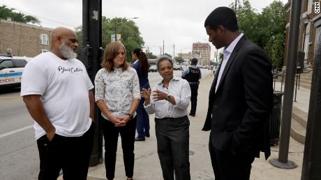 From left, TJ Crawford, director of the Garfield Park Rite to Wellness Collaborative; Gia Biagi, commissioner for city DOT; Mayor Lori Lightfoot; and CNN's Omar Jimenez