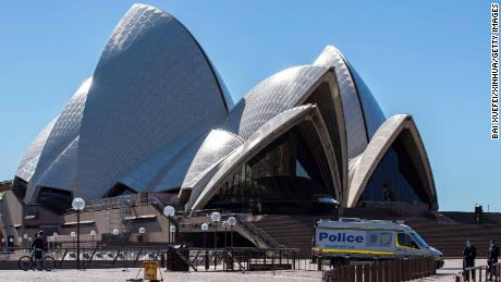 A police vehicle is seen near Sydney Opera House in Sydney, Australia, July 18, 2021. Rising COVID-19 cases sparked tougher restrictions with more retail closed in Australia's state of New South Wales NSW, the epicenter of the country's current outbreak, on Saturday. (Photo by Bai Xuefei/Xinhua via Getty Images)