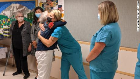 Rigney, pictured here hugging another staff member on her last day.