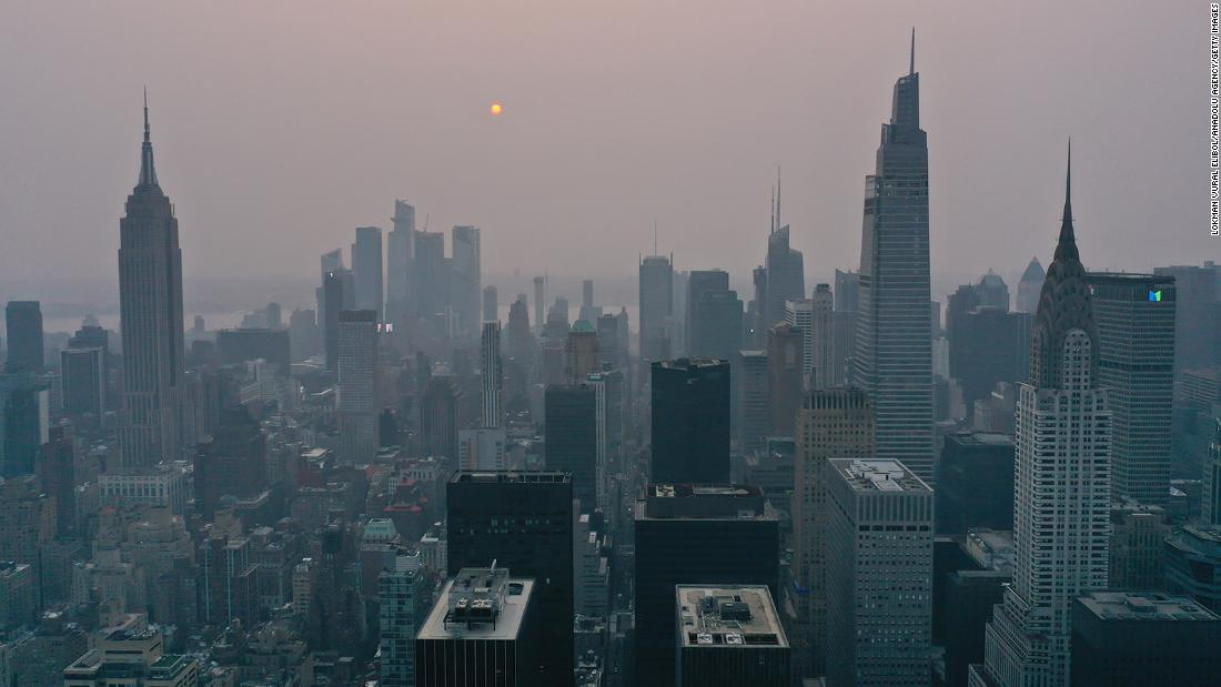Wildfires burning out of control across the western US send haze across the continent to New York City, on July 20.