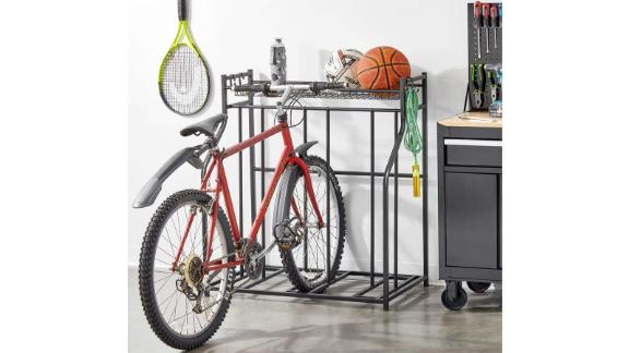 mDesign Free-standing metal bike rack with storage compartment
