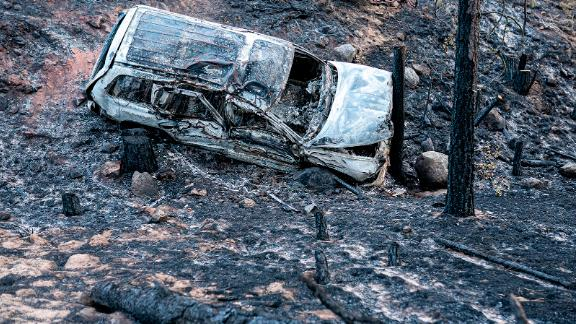 A car is charred by the Bootleg Fire along a mountain road near Bly, Oregon.