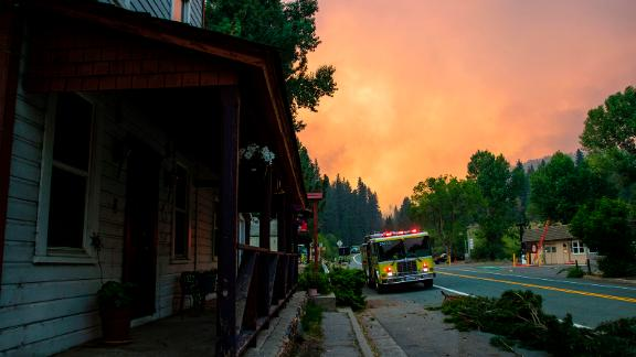 Firefighters work to protect Markleeville, California, from the Tamarack Fire on July 17. The Tamarack Fire was started by a lightning strike.