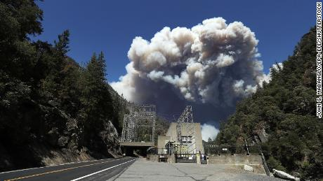 Heavy plumes of smoke billow from the Dixie fire above the Plumas National Forest near the Pacific Gas and Electric (PG&E) Rock Creek Power House.