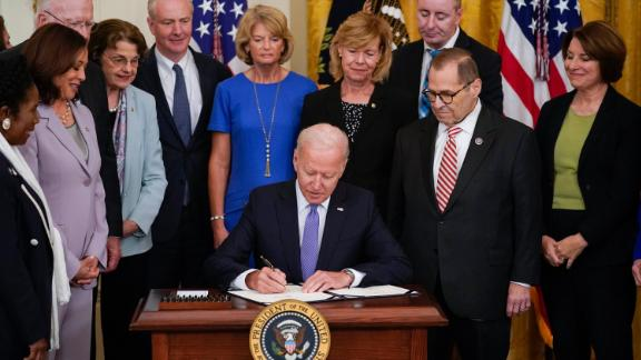 President Joe Biden signs H.R. 1652, the VOCA Fix to Sustain the Crime Victims Fund Act of 2021, on Thursday, July 22, 2021, in the East Room of the White House.