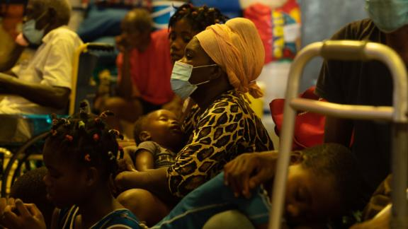 A woman and child sit inside Lekol Kominal school, which has been turned into a refugee camp, in Port-au-Prince.