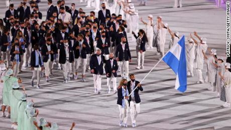 Flag bearers Cecilia Carranza Saroli and Santiago Raul Lange of Team Argentina lead their team in the stadium during the Opening Ceremony of the Tokyo 2020 Olympic Games.