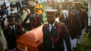 Fear stalks Haitians as their murdered president is buried and gangs terrorize the capital